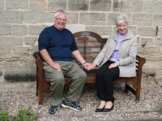 Glynnis & Mike ASTON on the Memorial Bench for their son outside the Parish Church, Coton- in- the- Elms. A lovely couple who made us feel welcome and very 'Humble' Thank you both.